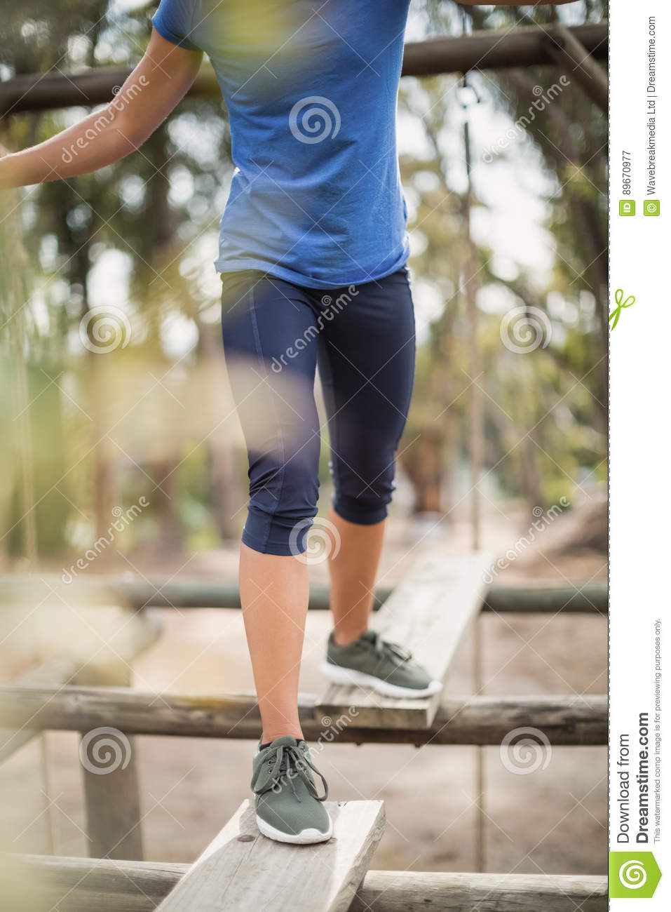 Fit woman during obstacle course training