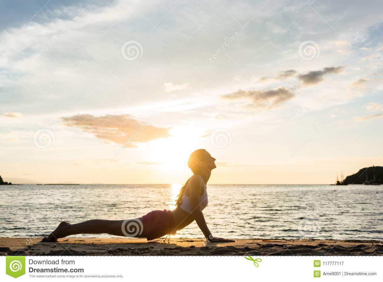 Fit Woman Practicing Stretching Through Cobra Yoga Pose On ...