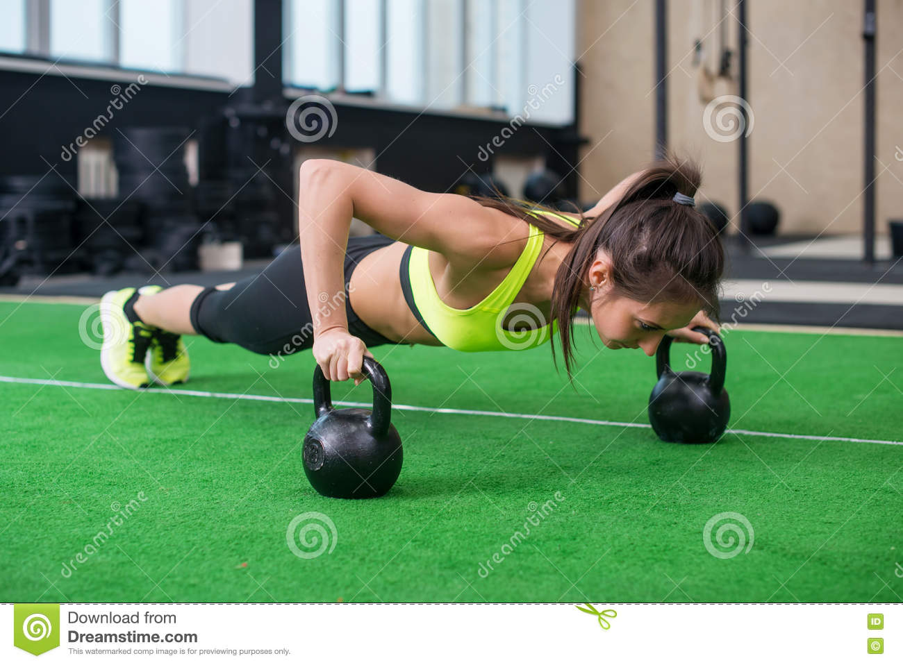 Fit Woman Young Doing Push Ups Exercise With Dumbbells In