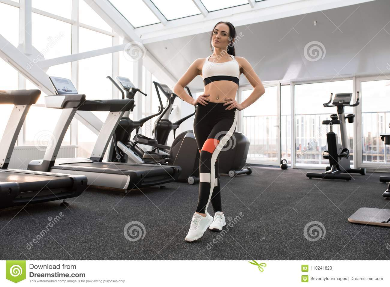 Fit Young Woman Posing in Gym