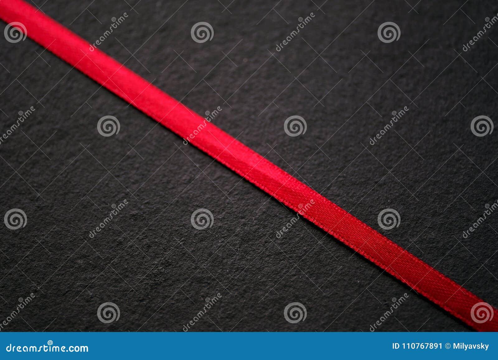 Fita vermelha no preto, textura