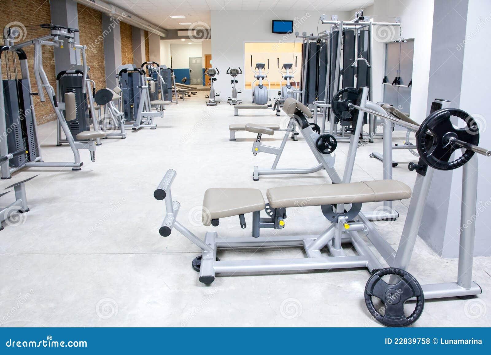 Fitness club gym with sport equipment interior royalty for Club gimnasio