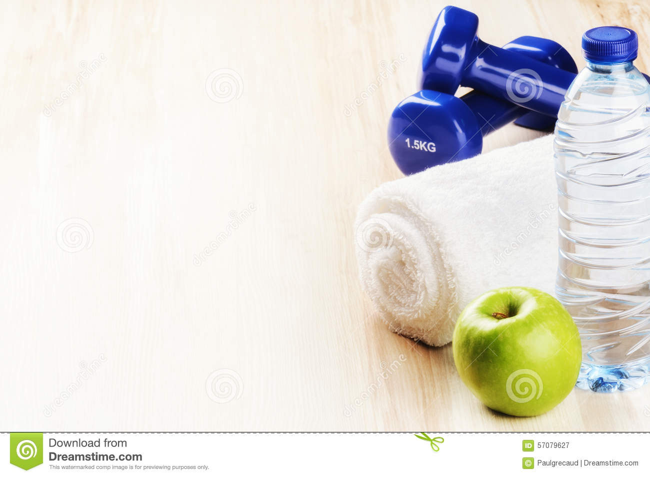 Dumbbells and apple royalty free stock photography