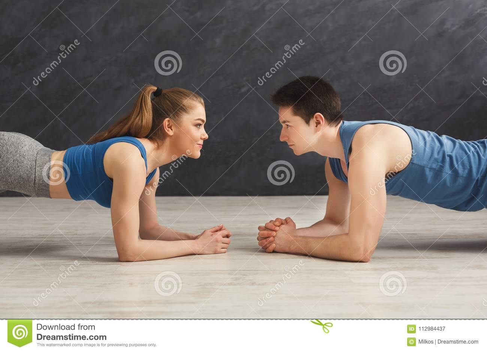 Fitness couple plank training indoors