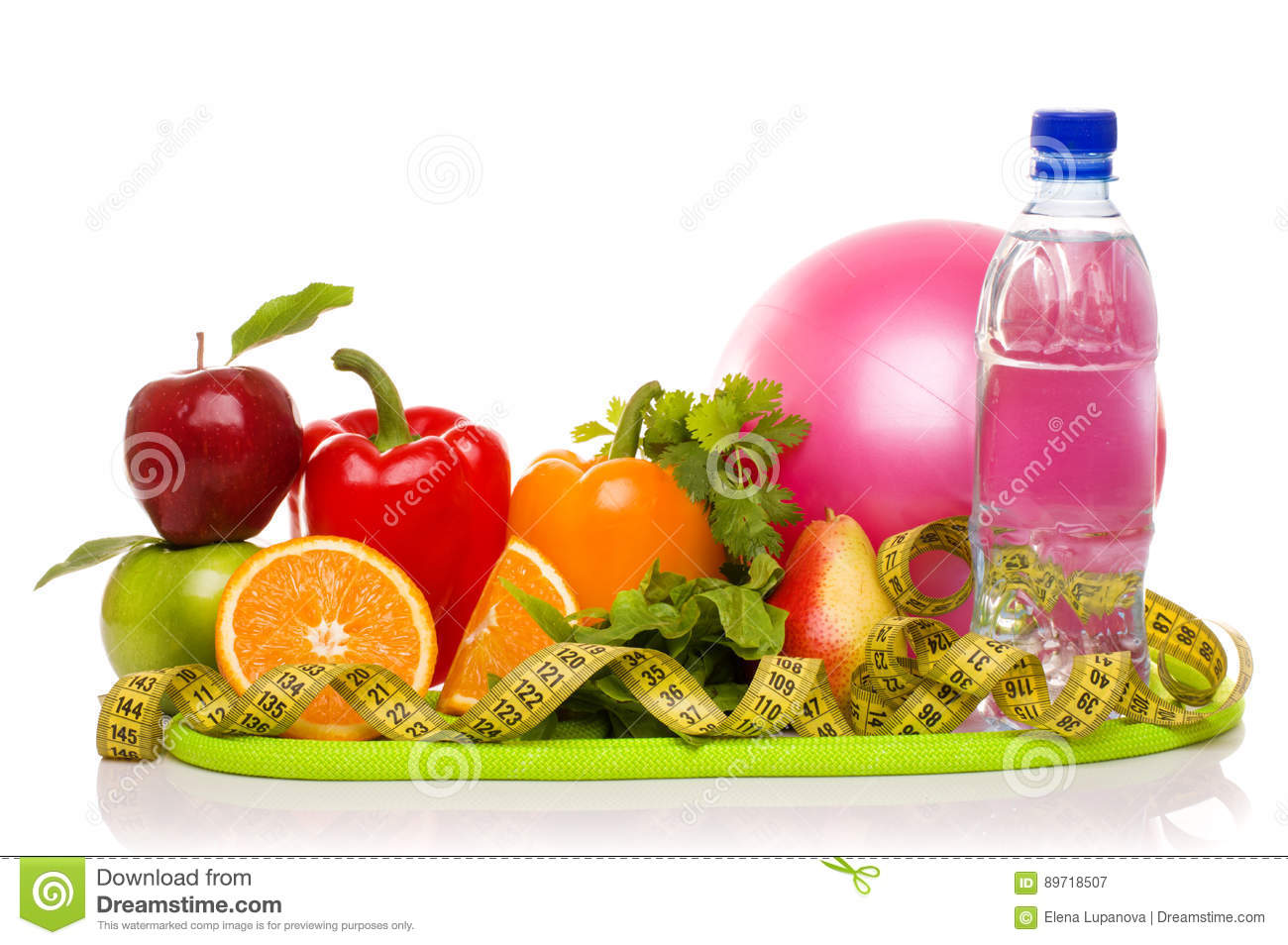 Blue dumbbells and red apple with measure tape stock photo