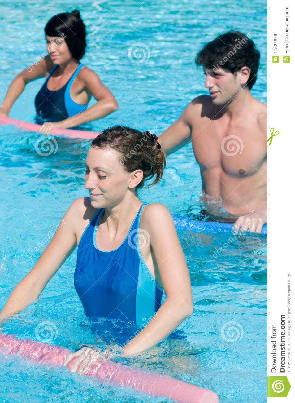 Free Swimming Pool: Smiling Fitness People Exercising In Swimming Pool Royalty