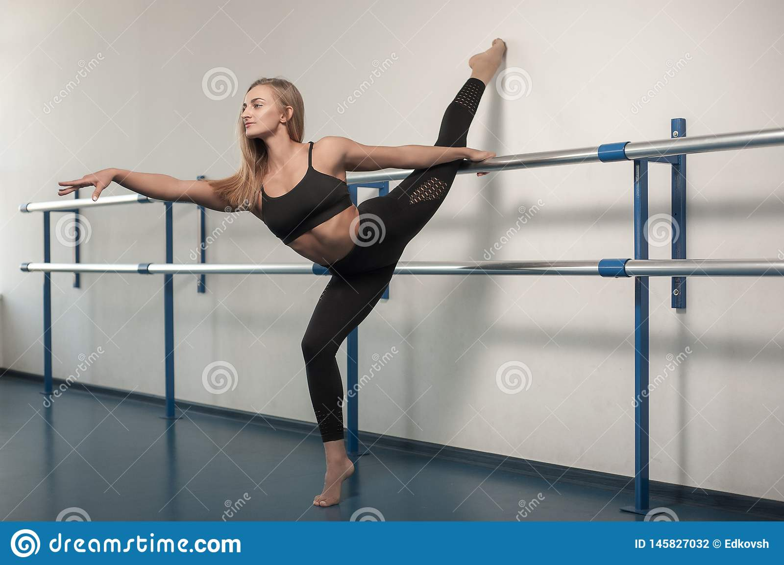 Fit girls preparing legs workout. Leg stretching exercise fitness woman doing warm-up, hamstring muscles stretch