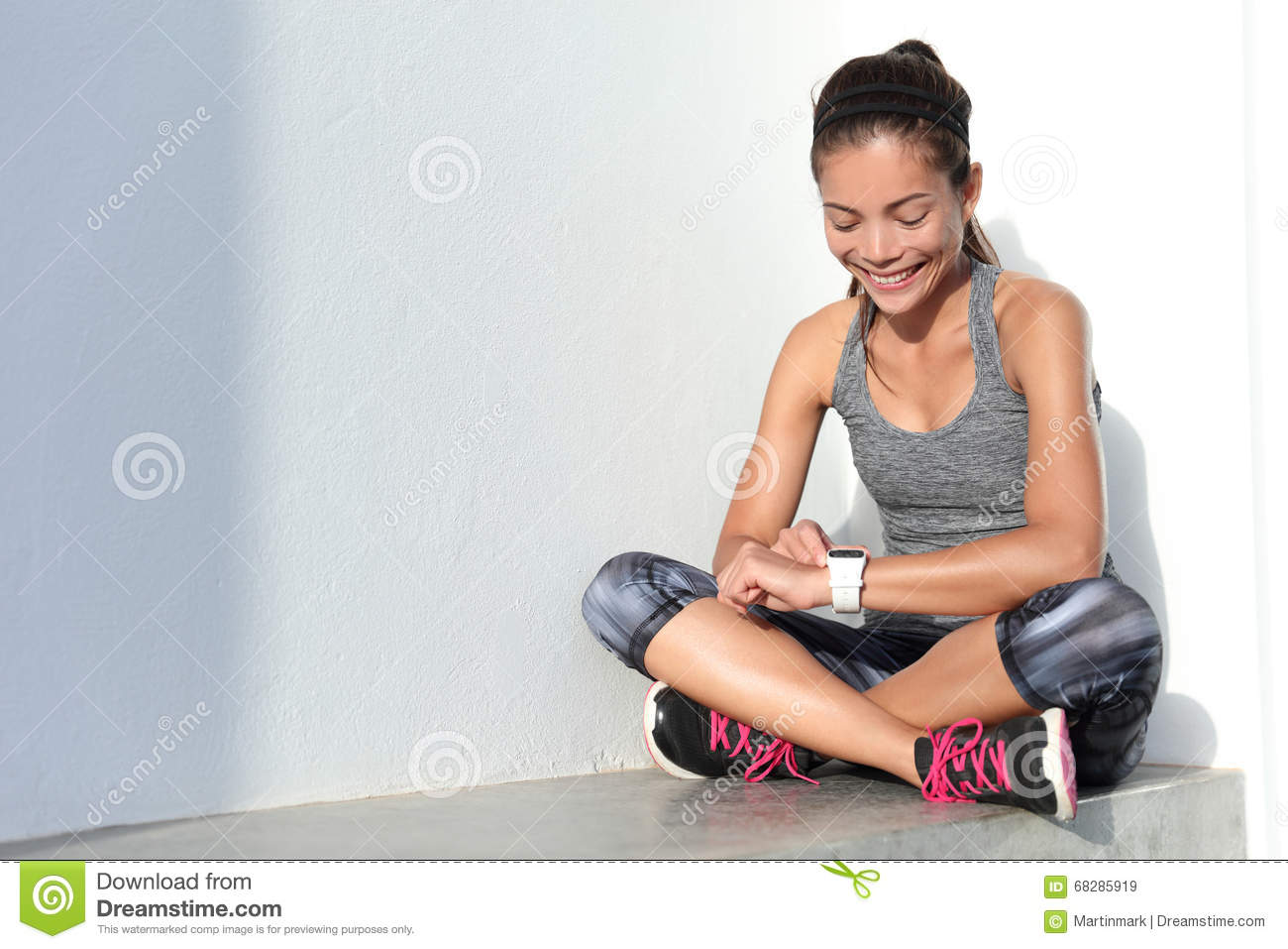 Fitness Girl Using Activity Tracker Smartwatch As Heart ...