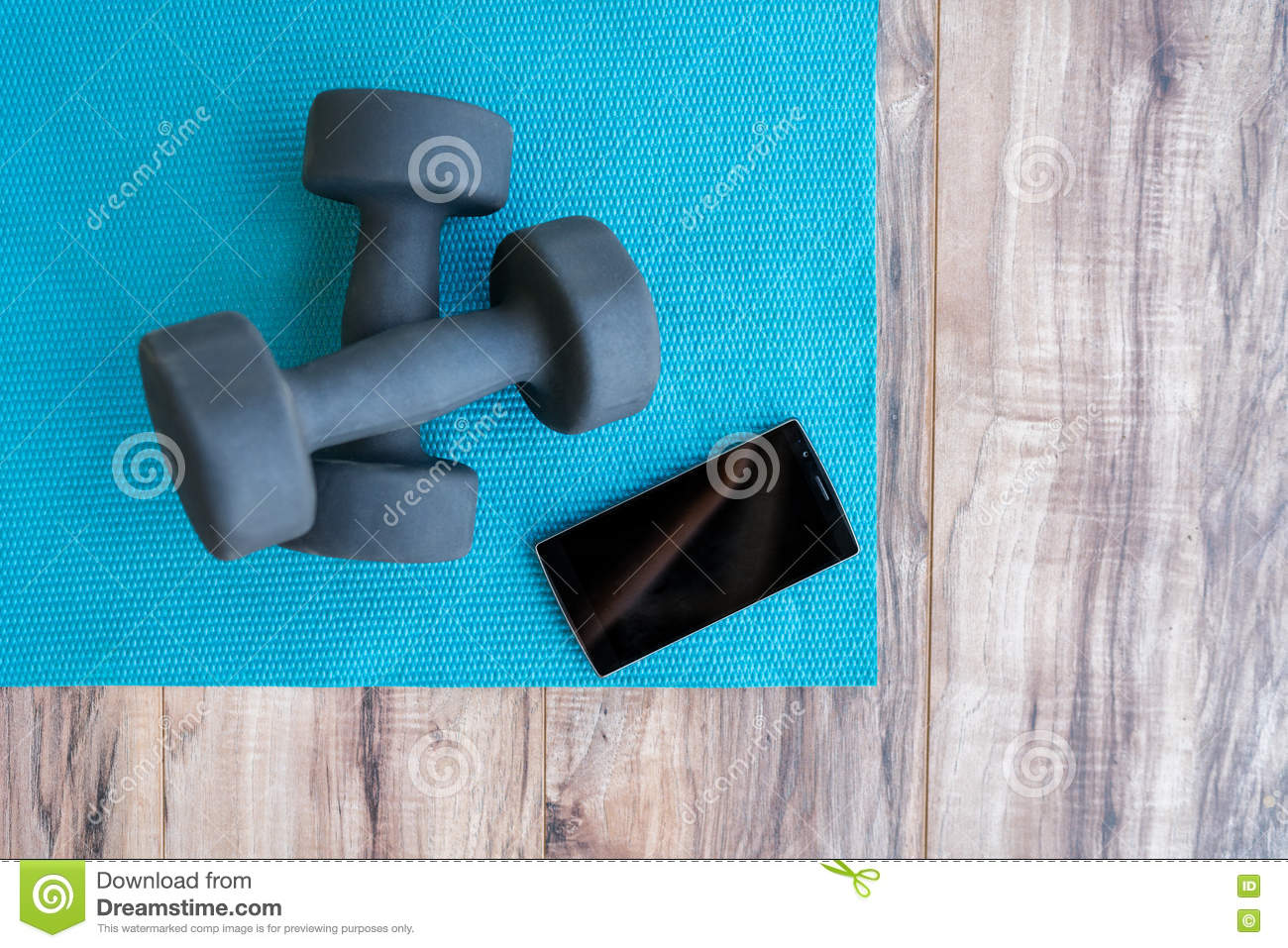 Fitness At Home-weights Yoga Mat Mobile Phone App Stock Image