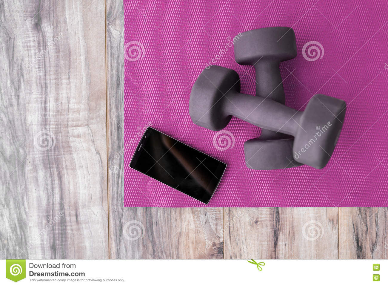 Fitness At Home-weights Yoga Mat Mobile Phone App Stock