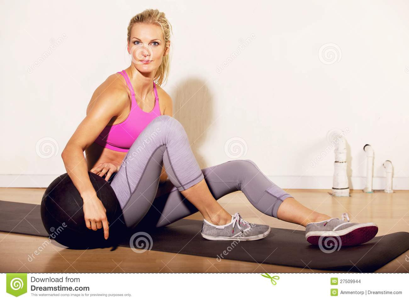 Fitness instructor at the gym with a pilates ball stock for Gimnasio pilates