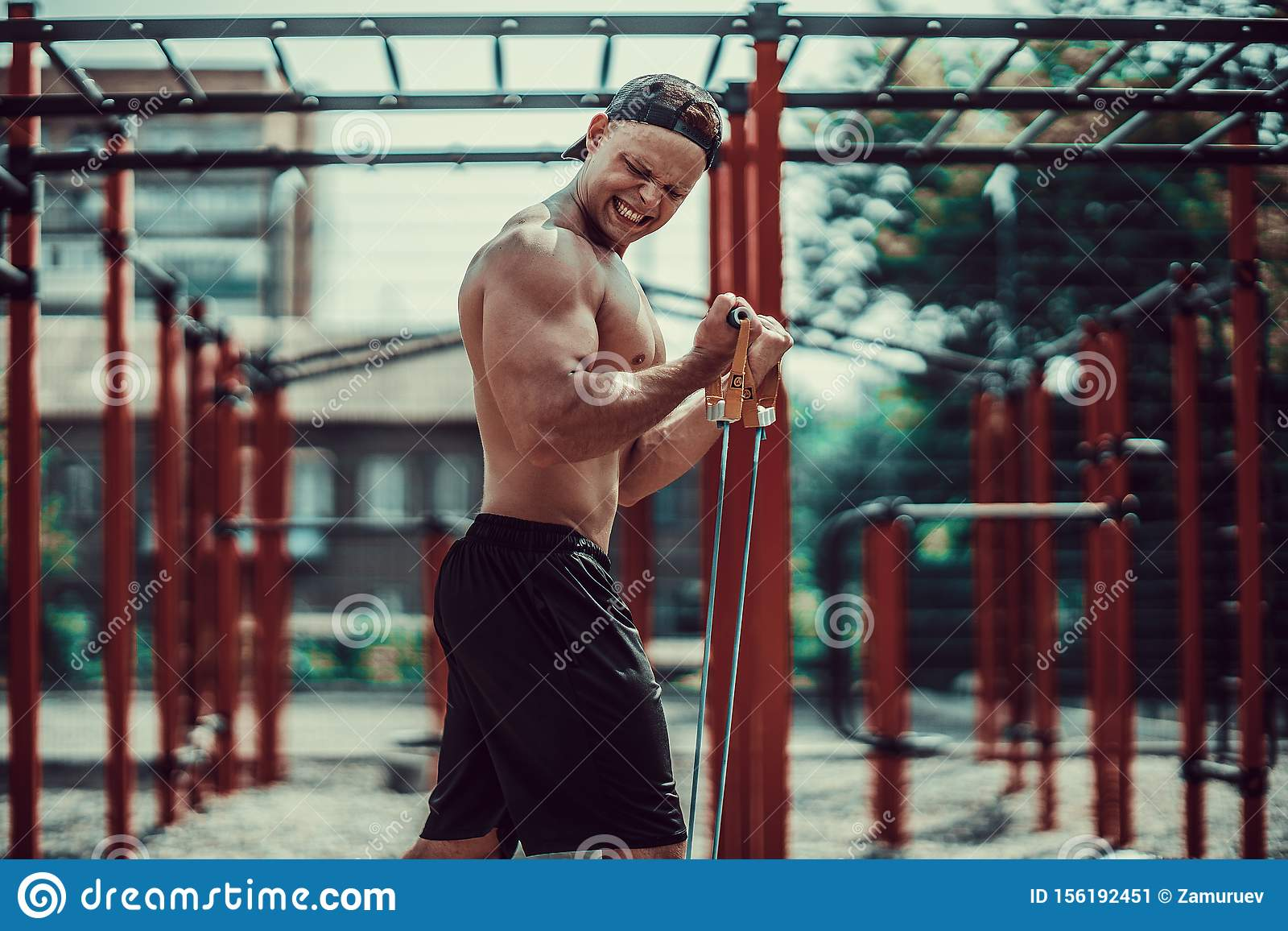 Workout Men Posing Outside. Sports And Fitness Concept