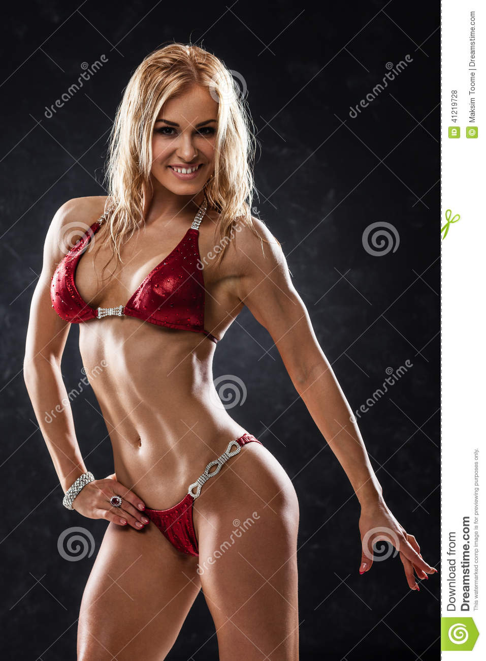 female fitness model showing abs stock image male models