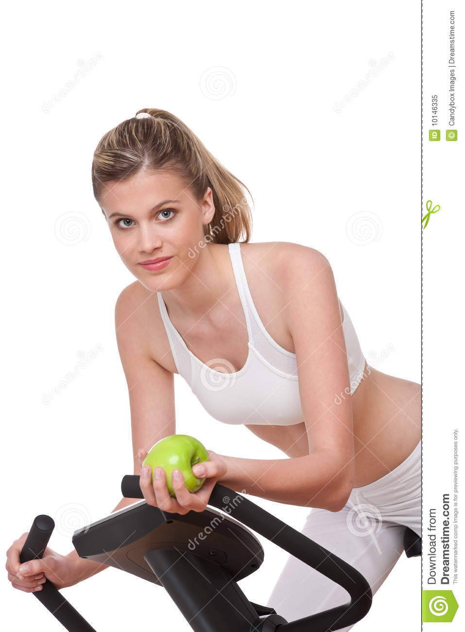 Fitness series - Woman holding apple