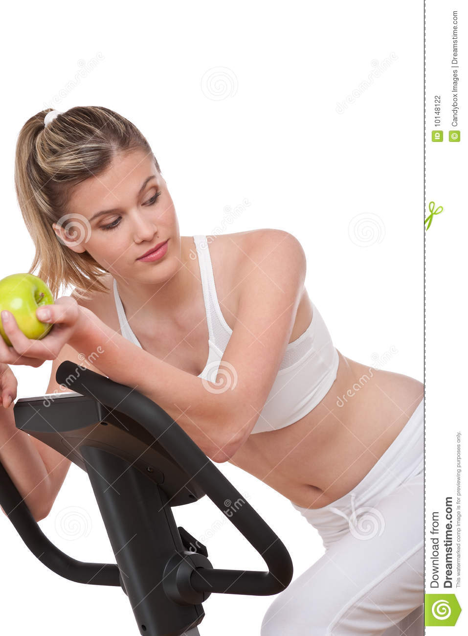 Fitness series woman holding green apple stock