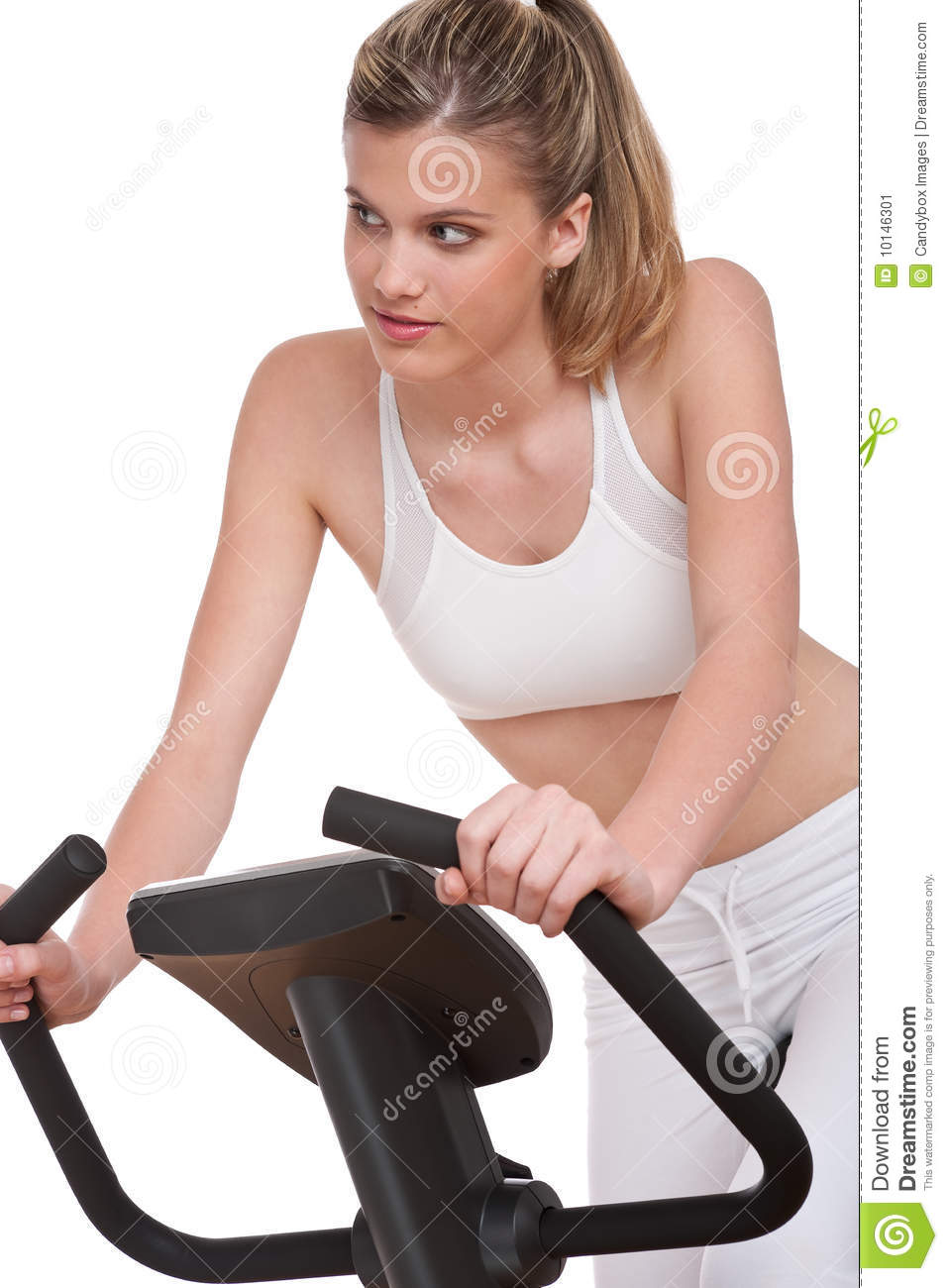 Fitness series - Young woman on exercise bike
