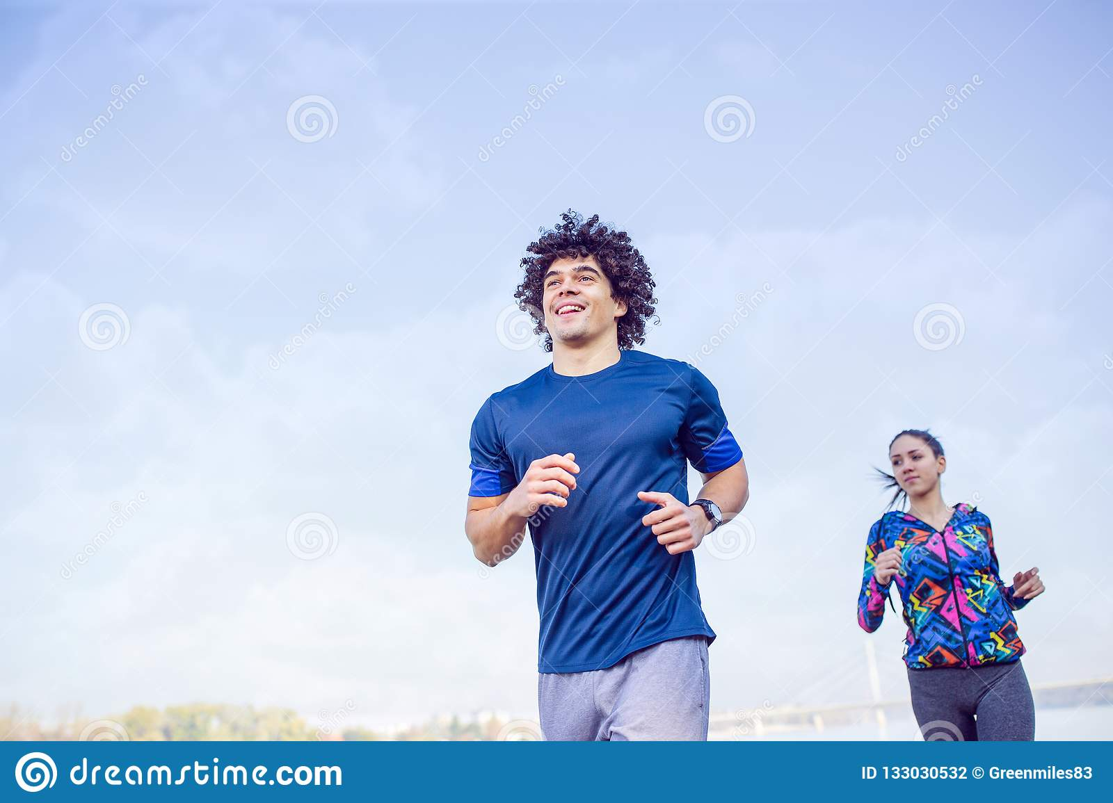 fitness, sport, exercising and healthy lifestyle concept - couple running or jogging.