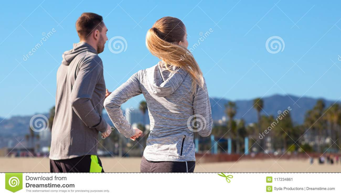 Happy Couple Running Outdoors Stock Image Image Of