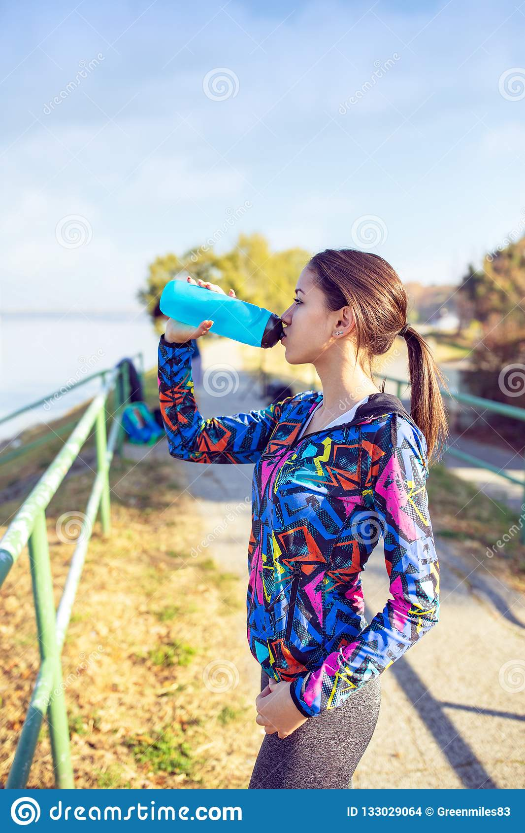 Fitness, sport, training and lifestyle concept -Woman drinking