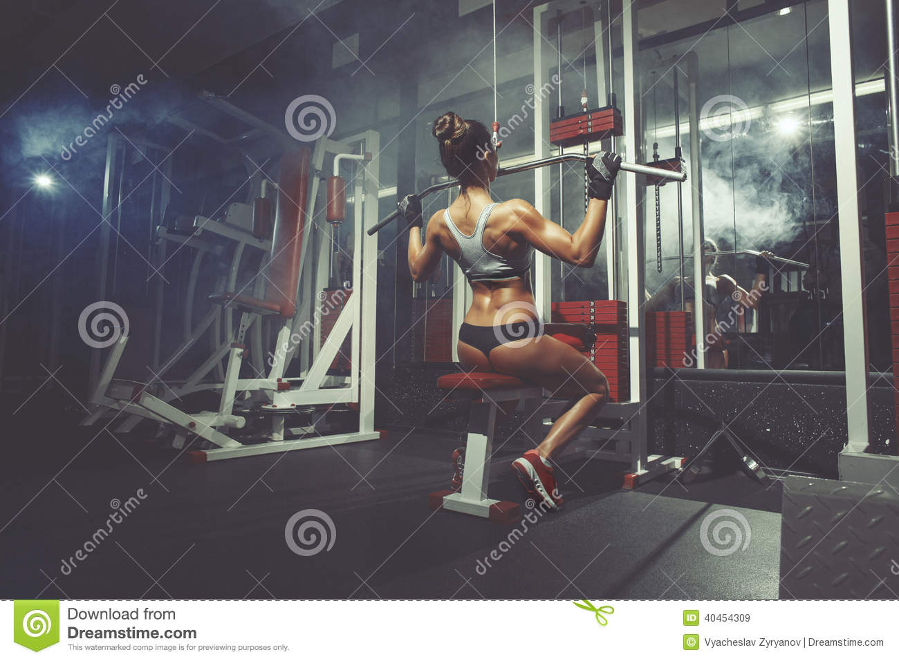 Fitness sport woman lifts in the gym