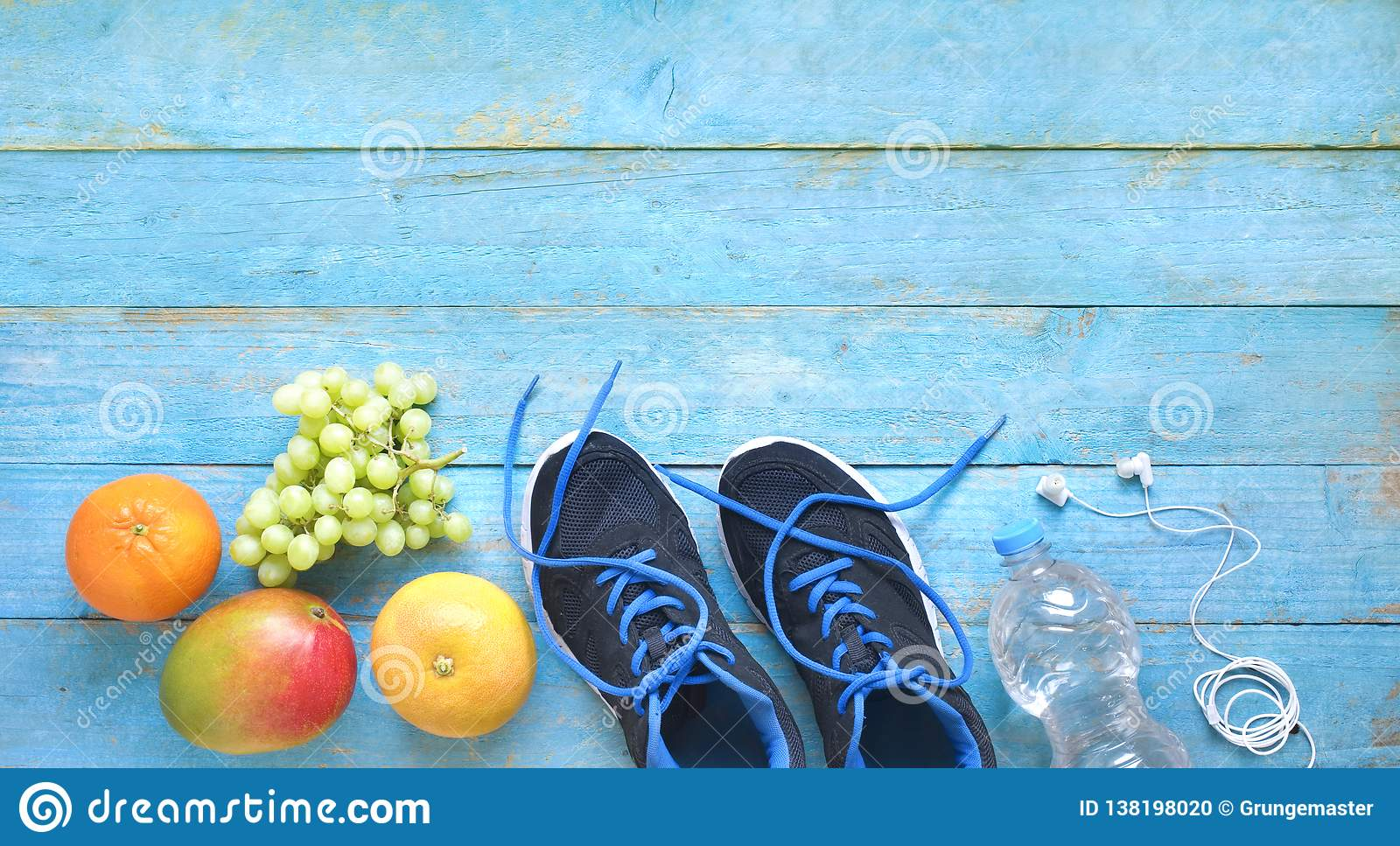 Fitness, sports and reducing weight for the springtime, pair of runners and fruit,free copy space,