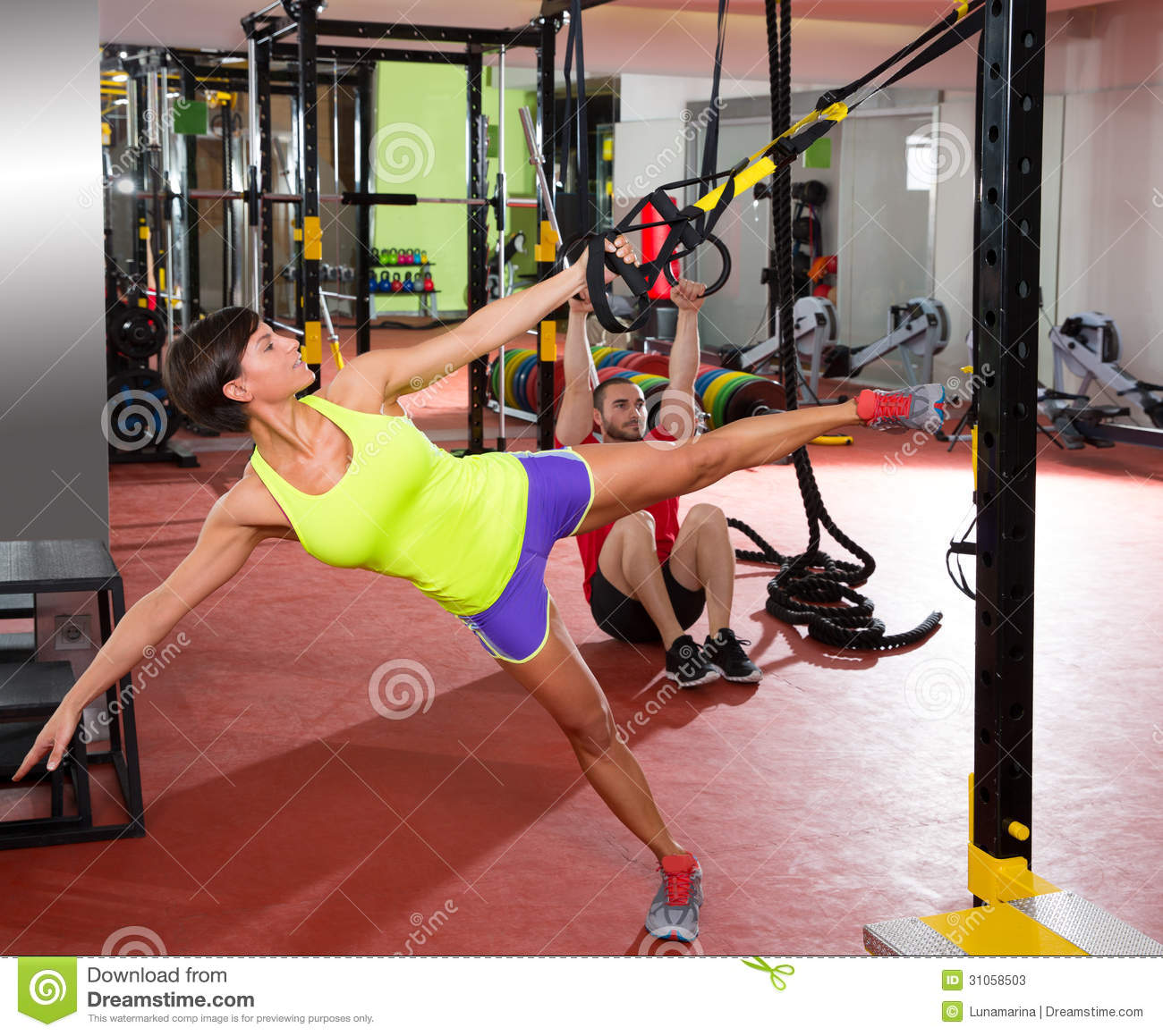 Amino Z Team Womens Weight Lifting Bodybuilding Gym: Fitness TRX Training Exercises At Gym Woman And Man Stock
