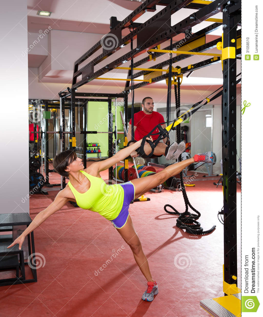 Fitness TRX Training Exercises At Gym Woman And Man Stock ...