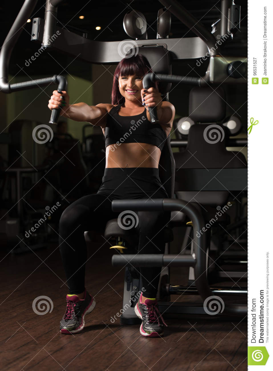 Woman Exercising Chest On Machine Stock Image - Image of