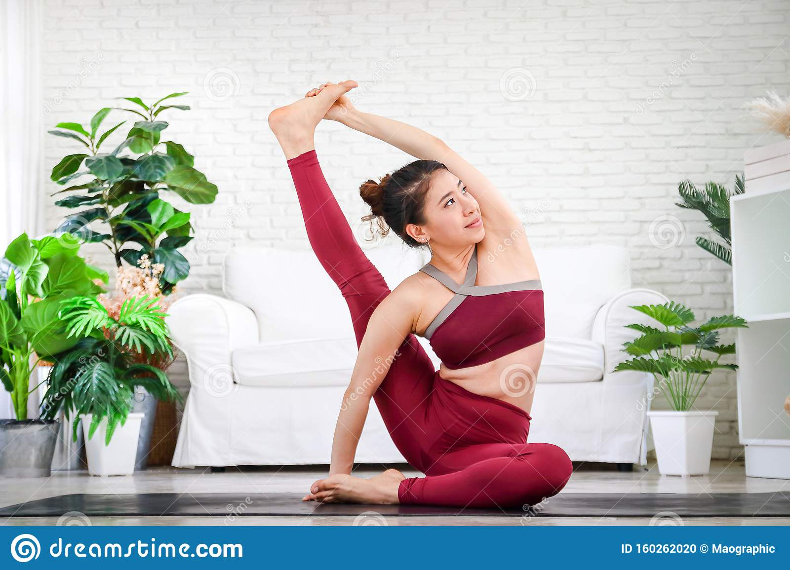 Asian Women Exercise And Do Yoga Pose At Home. Stock Photo ...