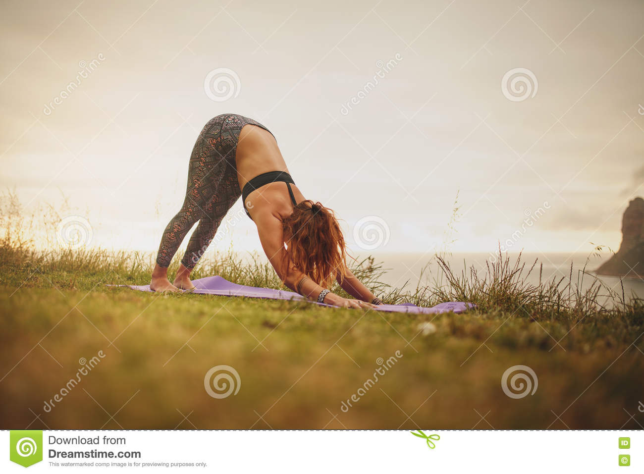 Download Fitness Woman Doing Yoga Outdoor Stock Photo