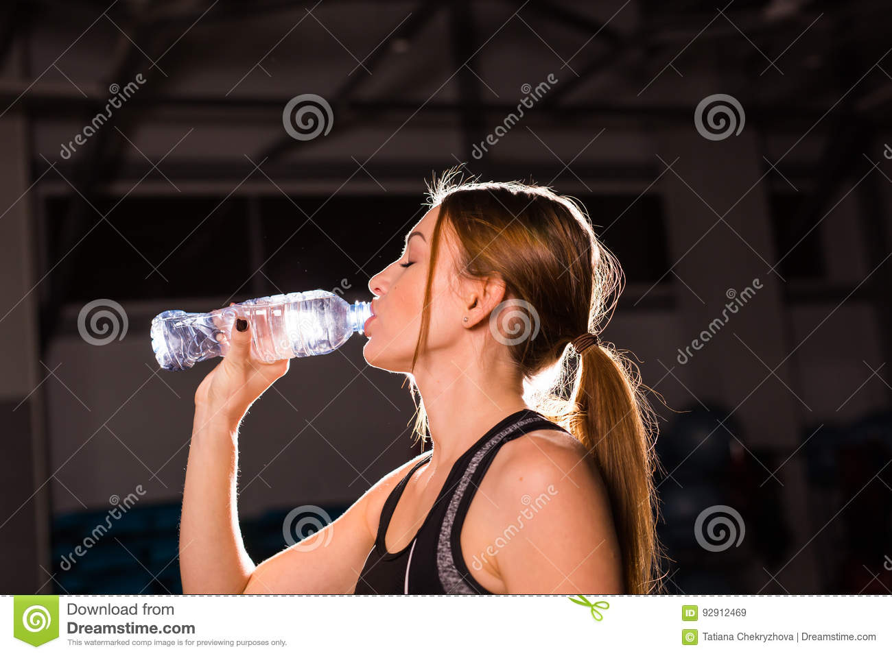 Fitness woman drinking water from bottle muscular young female at royalty free stock photo download fitness woman drinking water from bottle sciox Gallery