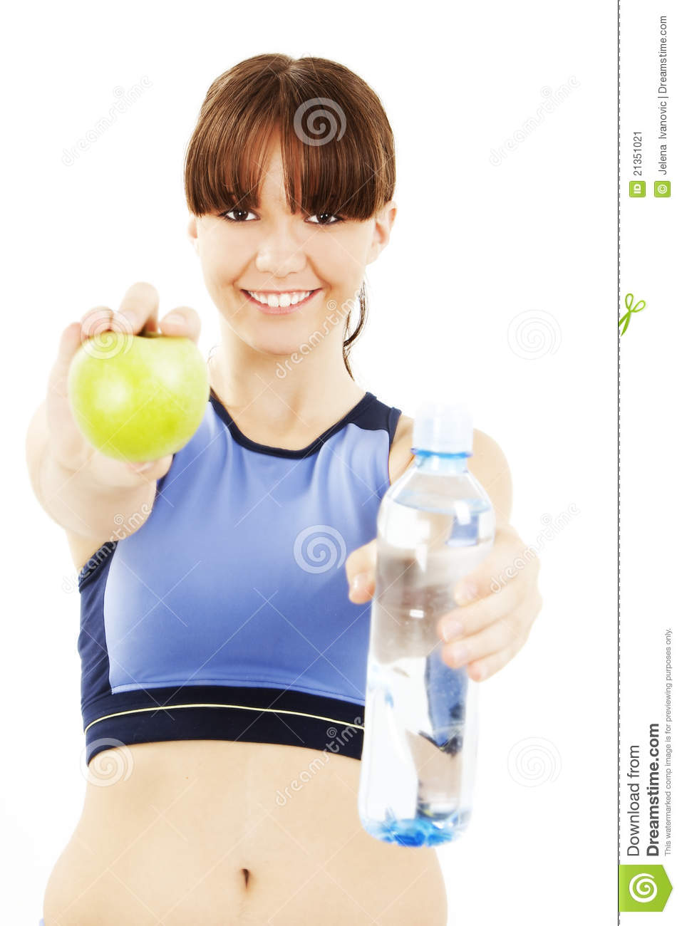 Fitness woman eating apple smiling happy