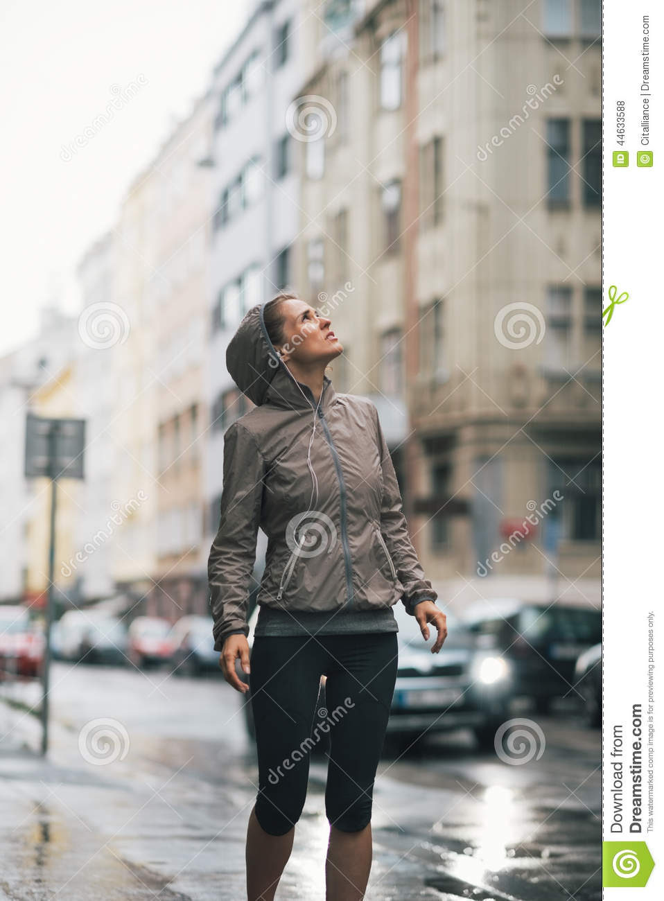 Fitness woman exposed to rain while jogging