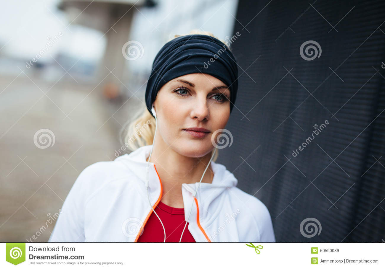 Fitness woman looking relaxed outdoors