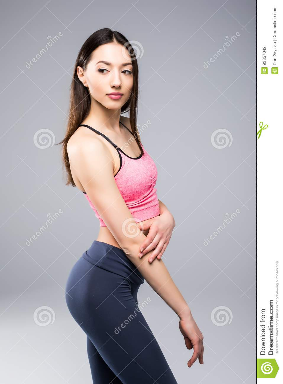 6c86f9afdd Fitness woman in sports clothes posing on gray background, studio shot