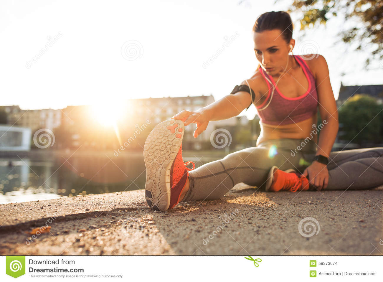 Fitness woman stretching before a run