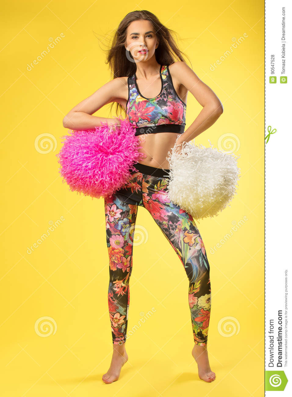 Fitness women on the yellow background.