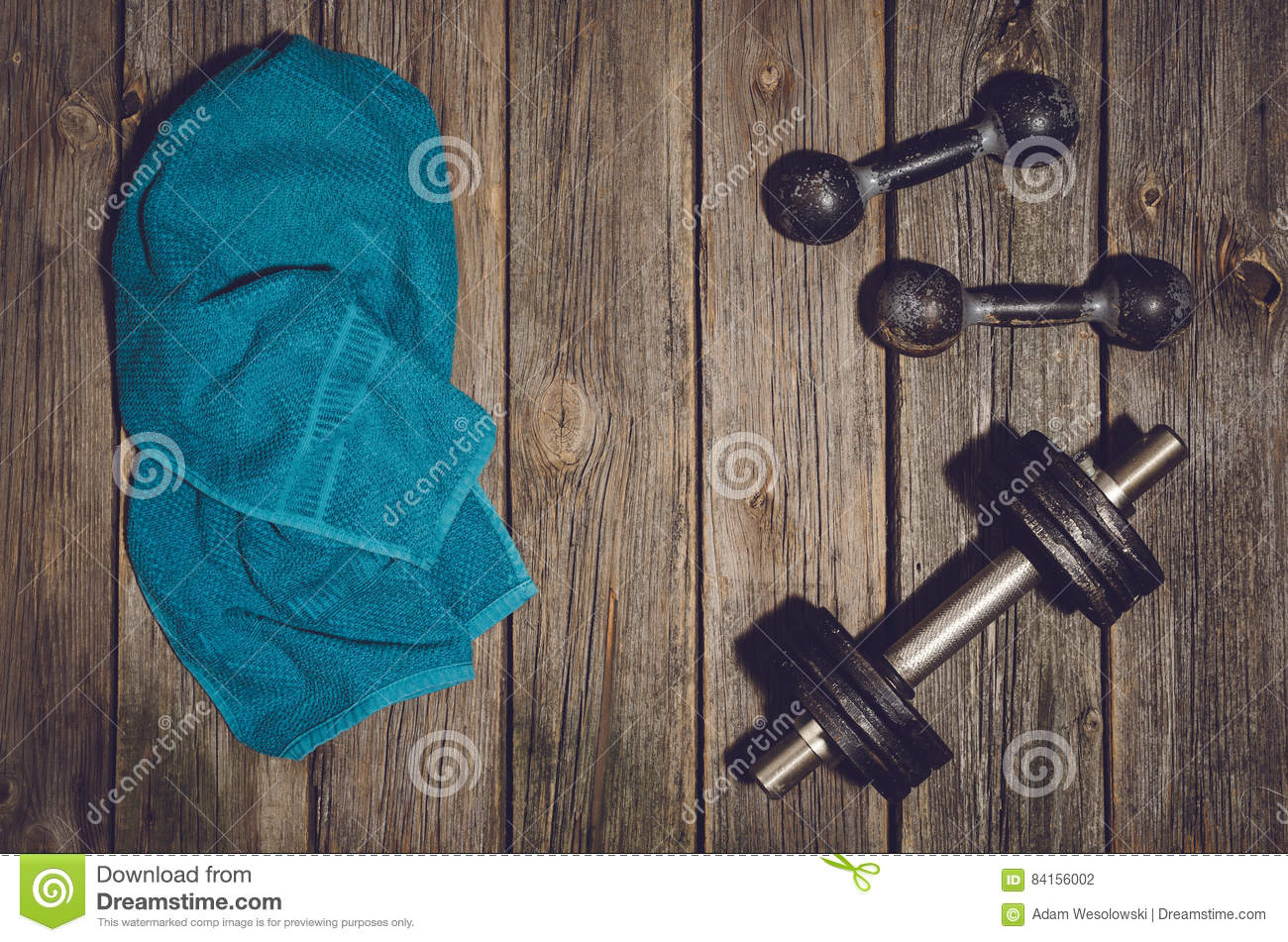 fitness workout background dumbbells on wooden gym floor or table