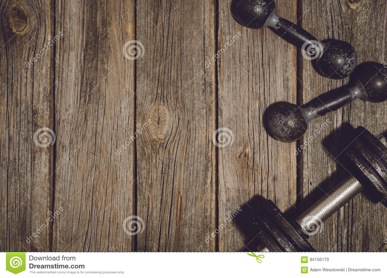 fitness workout background dumbbells on wooden gym floor