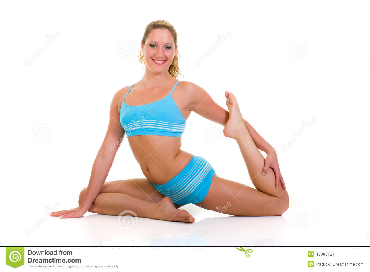 Young attractive female doing fitness, yoga exercises in the gym. Studio  shot