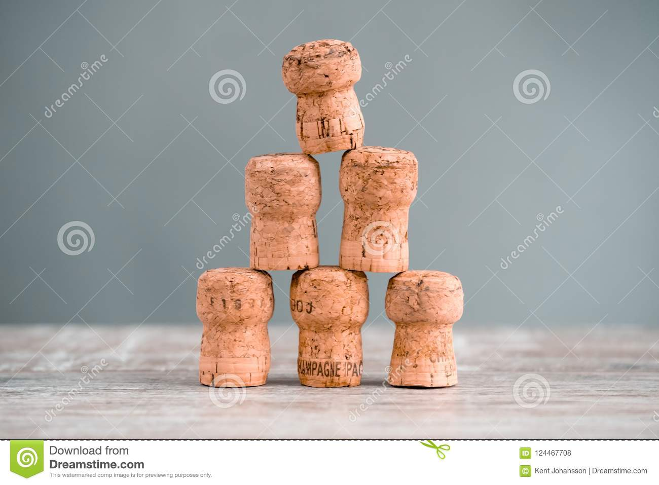 Five Champagne Corks Stapled as a Triangel
