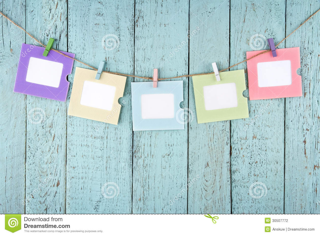 Five Empty Photo Frames Hanging With Clothespins Stock
