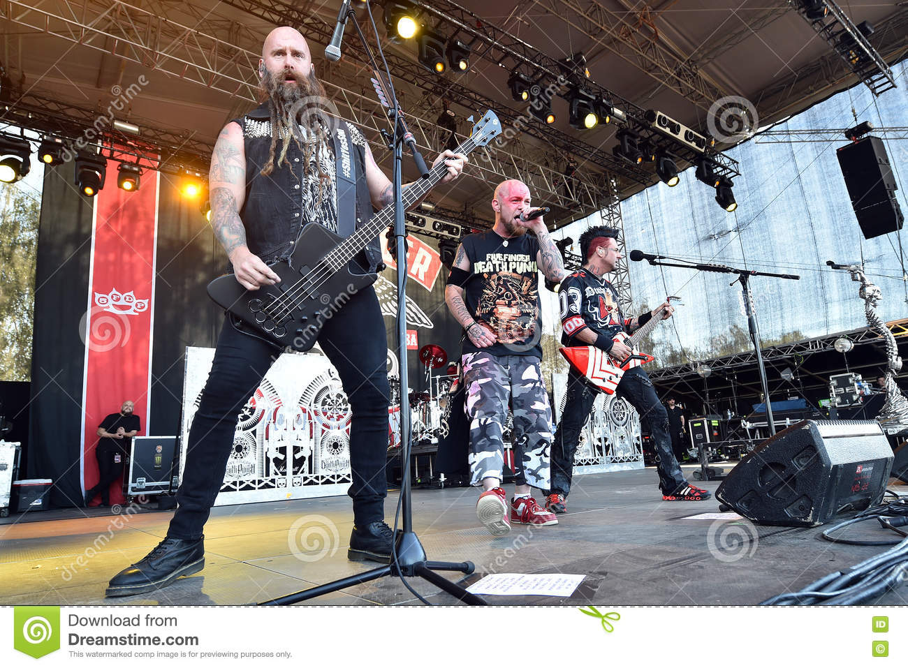 Bguitarist Chris Kael L Singer Ivan Moody M And Guitarist Jason Hook R Of Five Finger Punch During Performance At Festival Rock For People