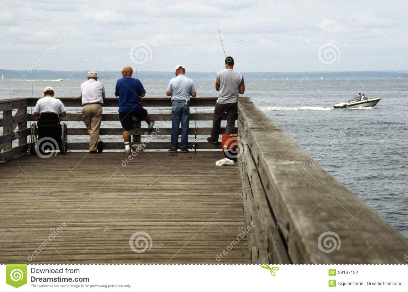 Five men fishing on a pier editorial photography image for Long island sound fishing