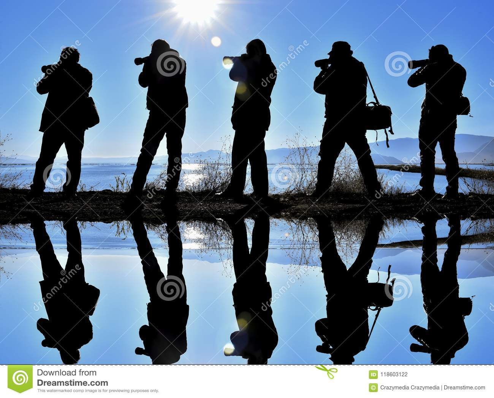 Five photographers beside a lake