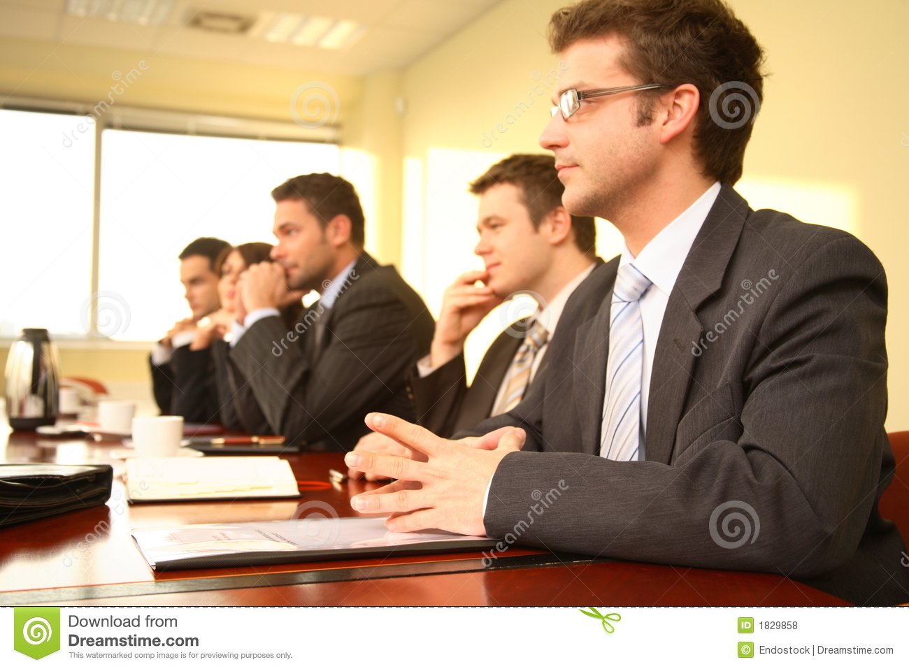 Five professionals at a Conference