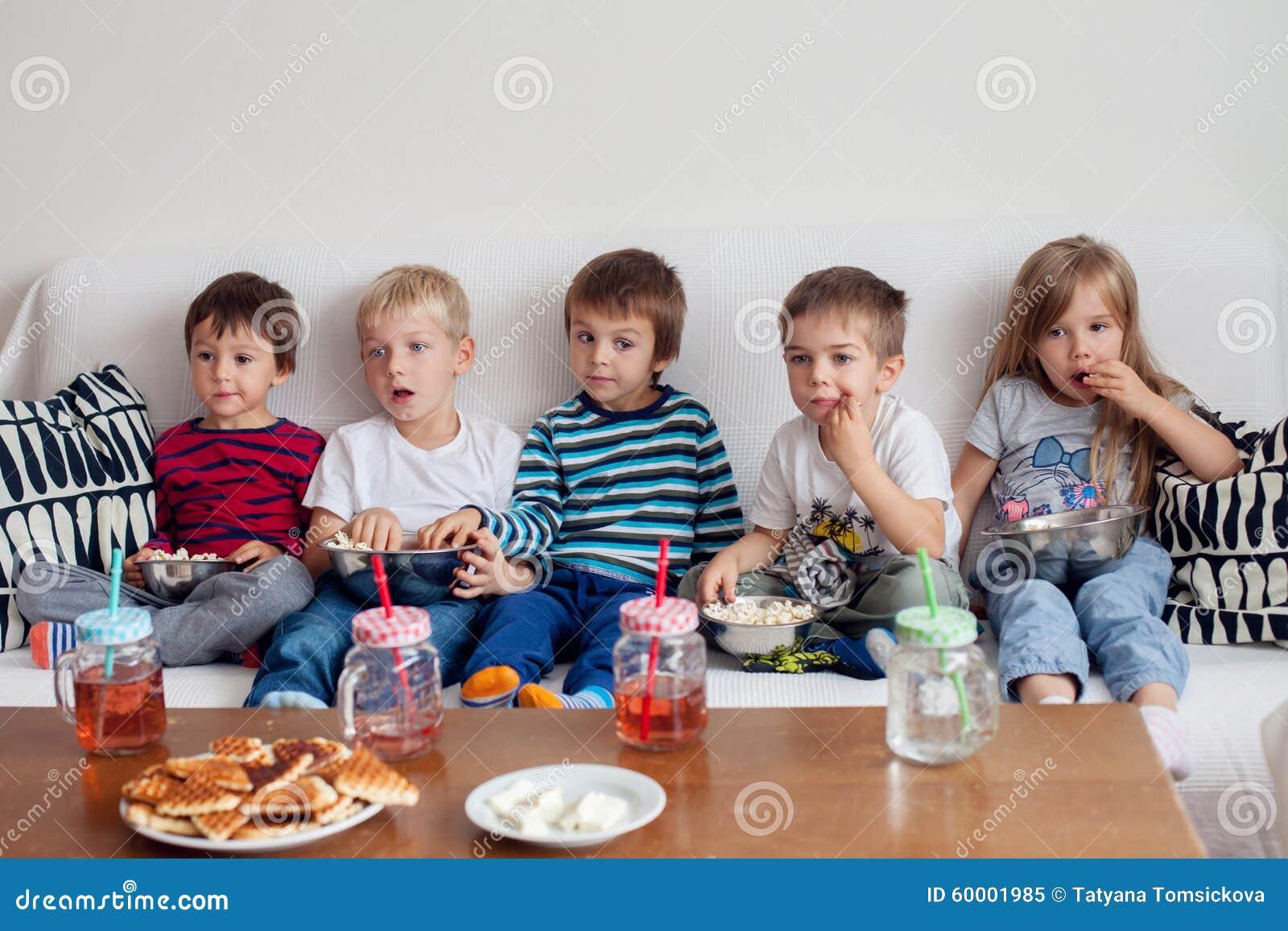 Five Sweet Kids, Friends, Sitting In Living Room, Watching ...