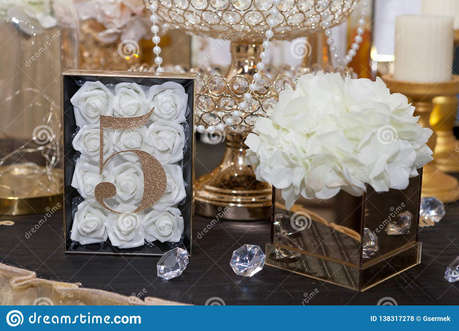 Five at table for guests on wedding dinner