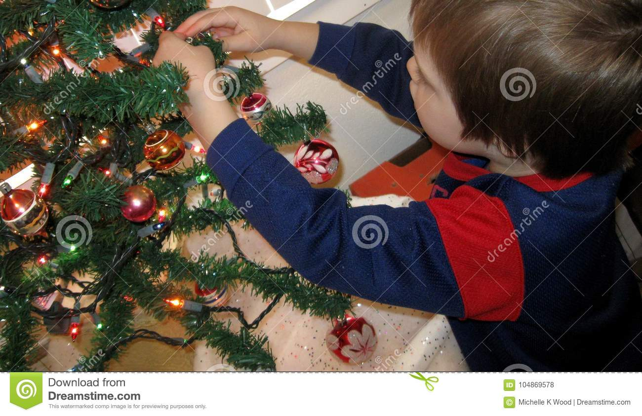 Five-year-old Boy Decorating Christmas Tree