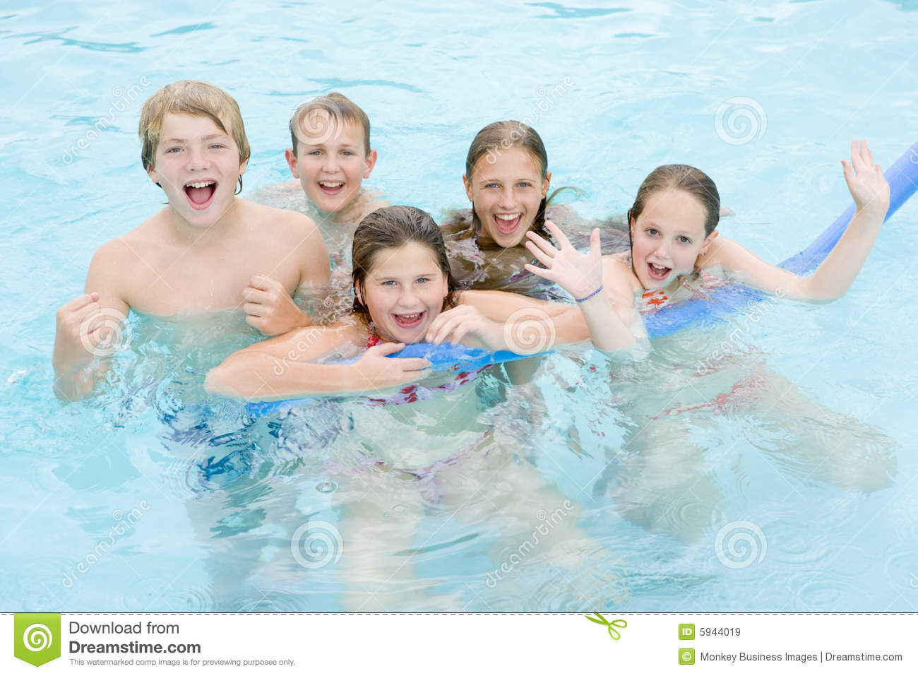 Five young friends in swimming pool playing